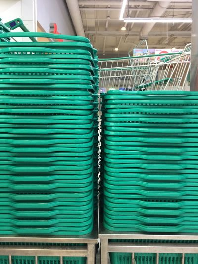 Stack Of Shopping Baskets At Supermarket