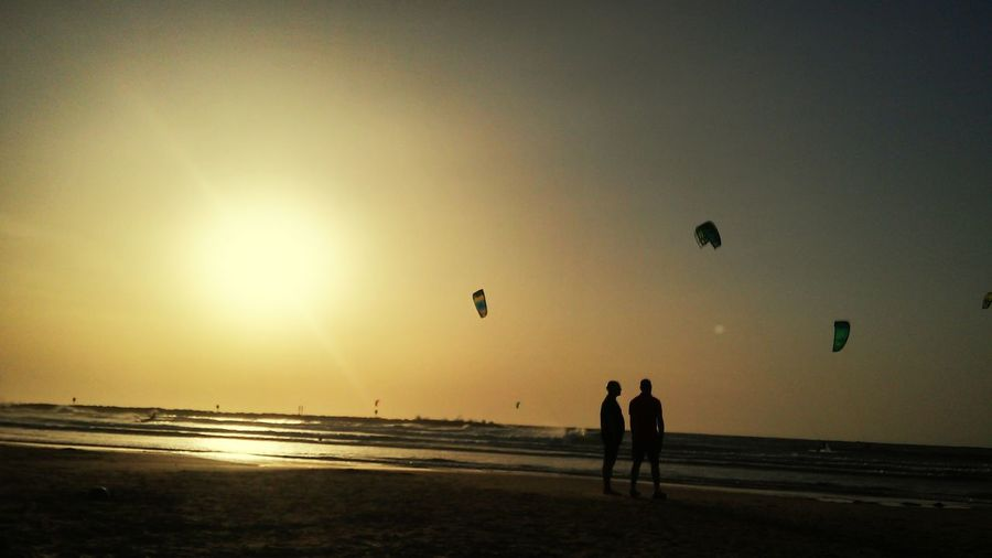 Beach Tel Aviv Israel Sun Set Flying Sunset Beach Sea Full Length Sand Boys Water Silhouette Togetherness Horizon Over Water Surf Ocean Paragliding Kiteboarding Parasailing