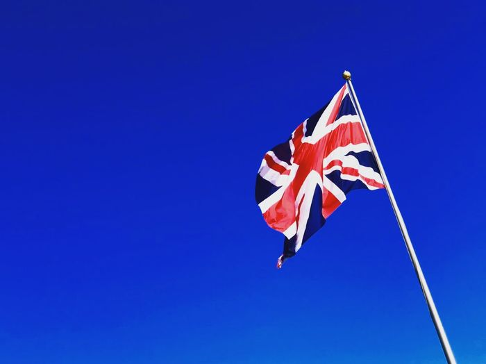 Union Jacked Travel Photography Travel Mobilephotography IPhoneography ShotOnIphone Blue Sky White Red Blue Uk United Kingdom Union Jack Flag Blue Sky Patriotism Low Angle View Flag Clear Sky Nature Day No People Freedom Outdoors Pole Wind Striped Waving Independence National Icon