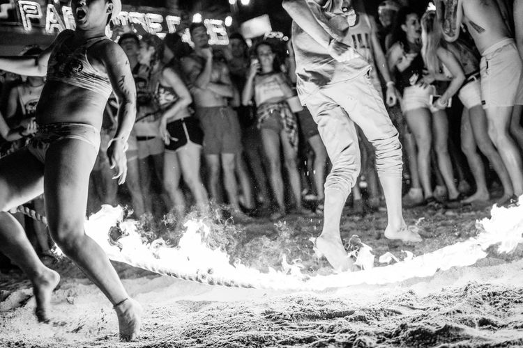 Thats Gotta hurt Koh Phangan Burnt Burning Flames Flame Flames & Fire Fire Rope Jump Shock Beach Black And White Bikini Motion Group Of People Crowd Large Group Of People Real People Women Low Section Emotion Outdoors Night Dangerous