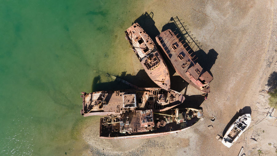 High angle view of old abandoned building by sea