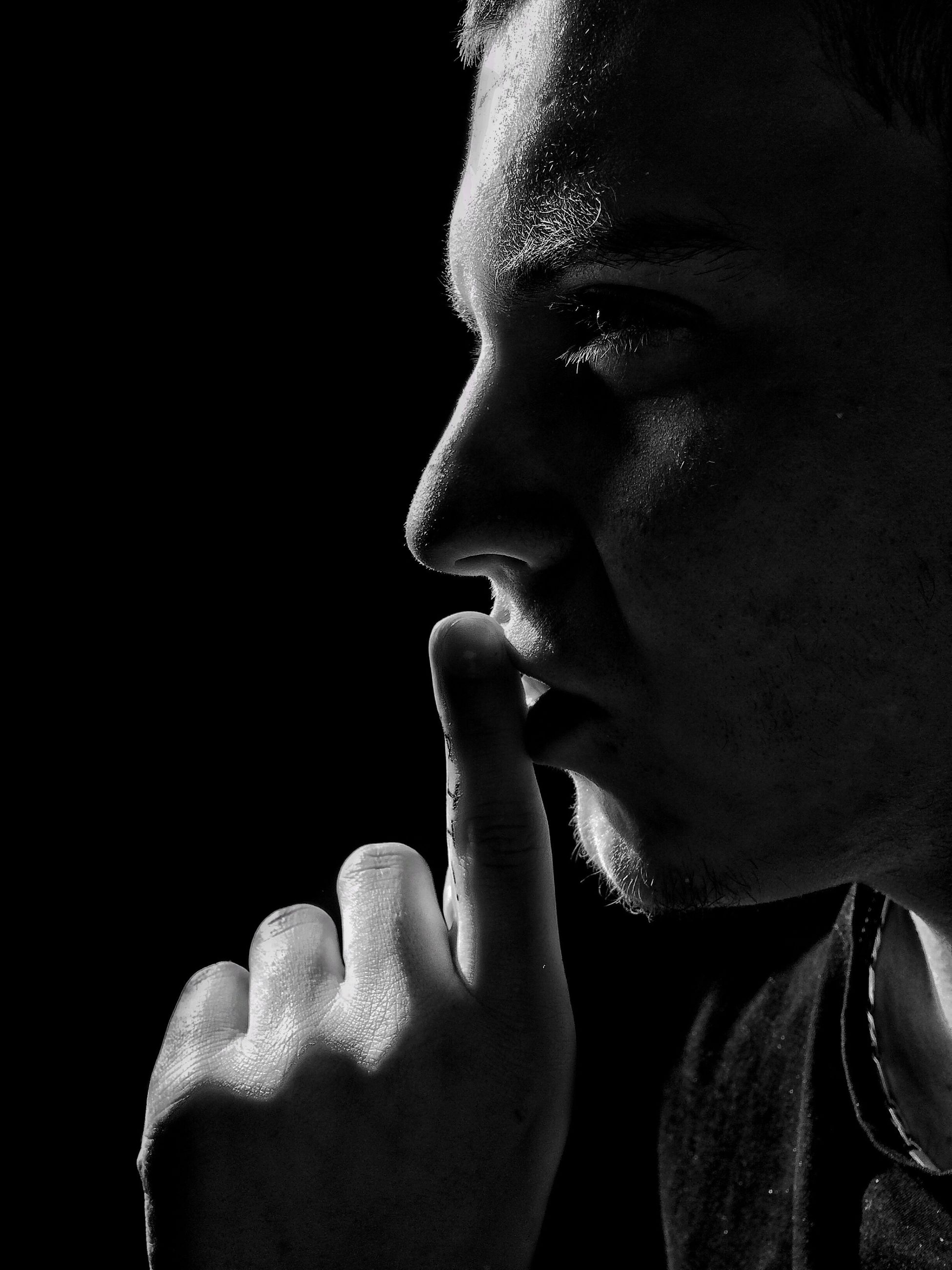black background, studio shot, headshot, lifestyles, close-up, young adult, human face, person, young men, leisure activity, serious, head and shoulders, front view, copy space, contemplation, indoors