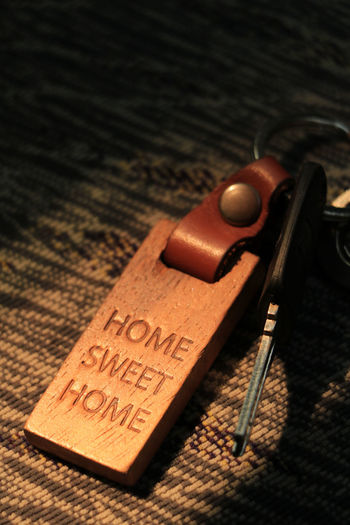 Home Domestic Life Keychain Key Protection Lock Access Home Sweet Home Indoors  Table Still Life No People Close-up Text High Angle View Antique Western Script Wood - Material Communication Brown Two Objects Old Security Leather Safety