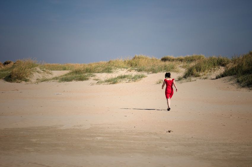 People And Places Woman In Red Woman Red Beach Sand Landscape Sand Dune Walking Solitude Clear Sky Casual Clothing Nature Summer Outdoors Danmark Danmark Rømø Romo  Nordsee Northsea People And Places.