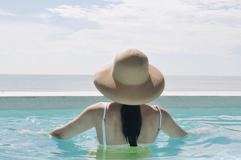 Sweet Water One Person Sea Leisure Activity Real People Rear View Nature Vacations Trip Holiday Hat Lifestyles Clothing Day Swimming Pool Adult Sky Summer Outdoors Horizon Over Water