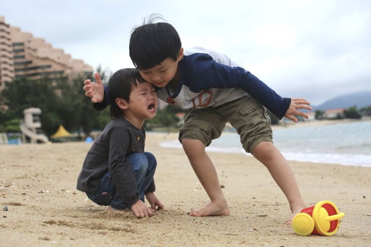 Boy playing with ball on beach