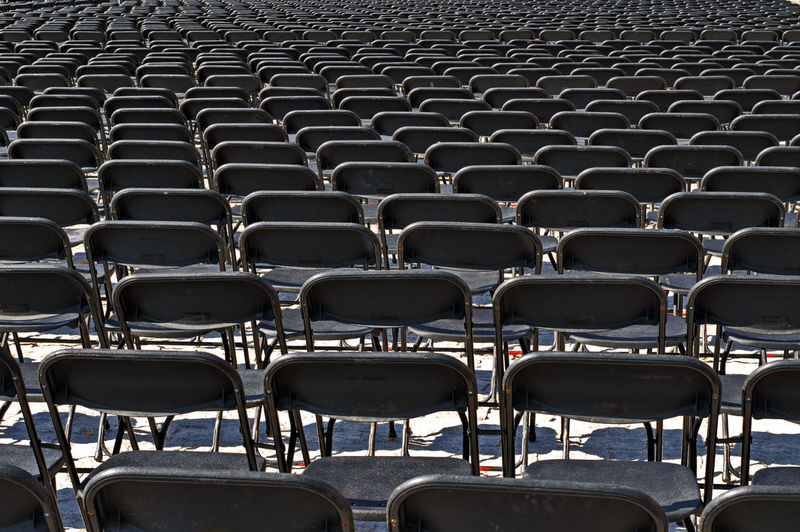 Full frame shot of empty chairs in row