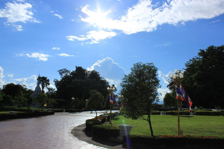 Scenic view of park against sky on sunny day
