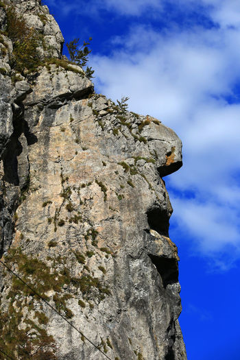 EyEmNewHere Cliff Clouds And Sky Colours Of Nature Day Human Face Rock Low Angle View Nature No People Outdoors Rock - Object Rock Face Scenics Surprising Nature Surprising Rock Formation Transylvania💕