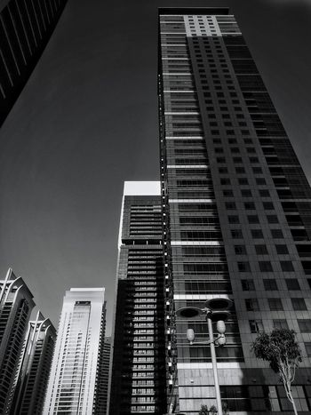 Dubai Architecture City Building Exterior Skyscraper Low Angle View Built Structure City Life Travel Destinations Outdoors No People Tower Modern Night Sky Corporate Business Cityscape Taking Photos Black Background HuaweiP9 Huaweiphotography Huawei P9 Leica Huawei Shots EyeEm Best Shots - Black + White Lines Clear Sky