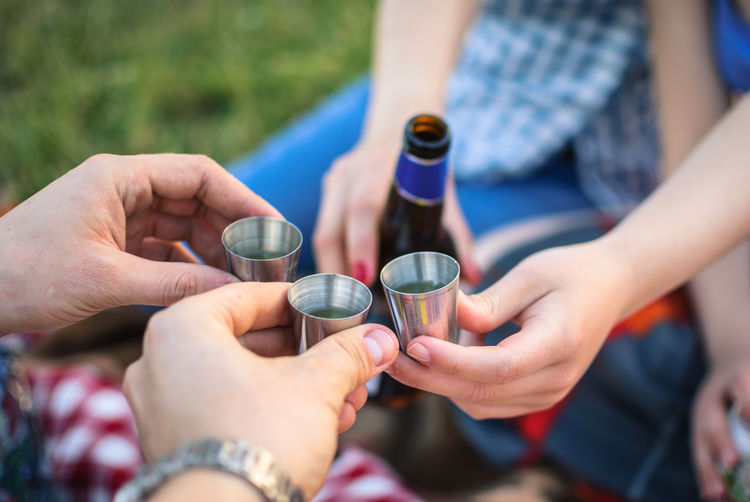 Having good time with friends Alcohol Celebration Cheers Food And Drink Friendship Fun Lifestyles Men Outdoors People Real People Togetherness Women Crafted Beauty Food Stories