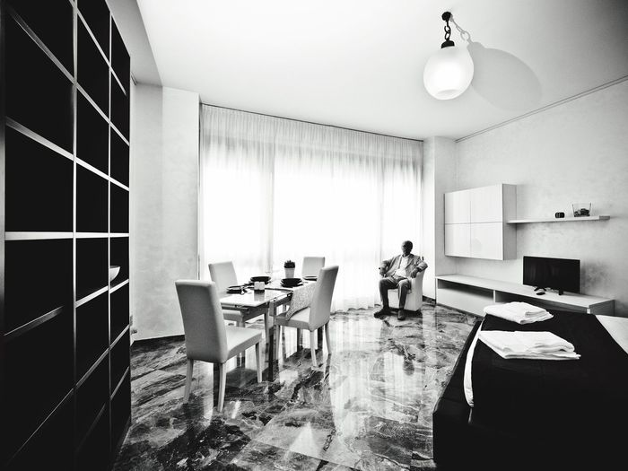 Negative Space // Milano Indoors  One Person Table Home Interior Chair Real People Technology Domestic Room Only Women Living Room Architecture Adult Furniture Adults Only Domestic Life Home Showcase Interior People Sitting Milano Italy Milan Blackandwhite Monochrome Wide Angle