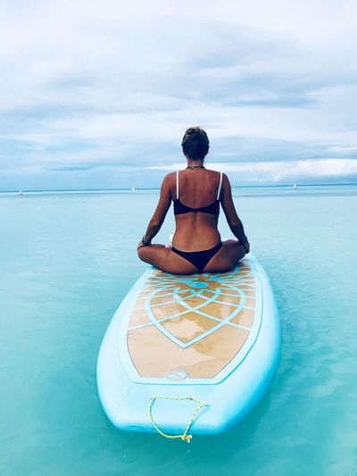 Sup Stand Up Paddle #SUP Stand Up Paddling Yoga ॐ Yoga Life EyeEm Selects Sea Water Horizon Over Water Sky Nature Tranquil Scene Full Length One Person Beauty In Nature Yoga Outdoors Sitting Tranquility Lifestyles