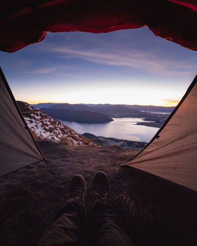 Wanaka Beauty In Nature Body Part Cloud - Sky Environment Human Body Part Human Foot Human Leg Leisure Activity Lifestyles Low Section Mountain Mountain Range Nature One Person Outdoors Personal Perspective Real People Royspeak Scenics - Nature Shoe Sky Unrecognizable Person