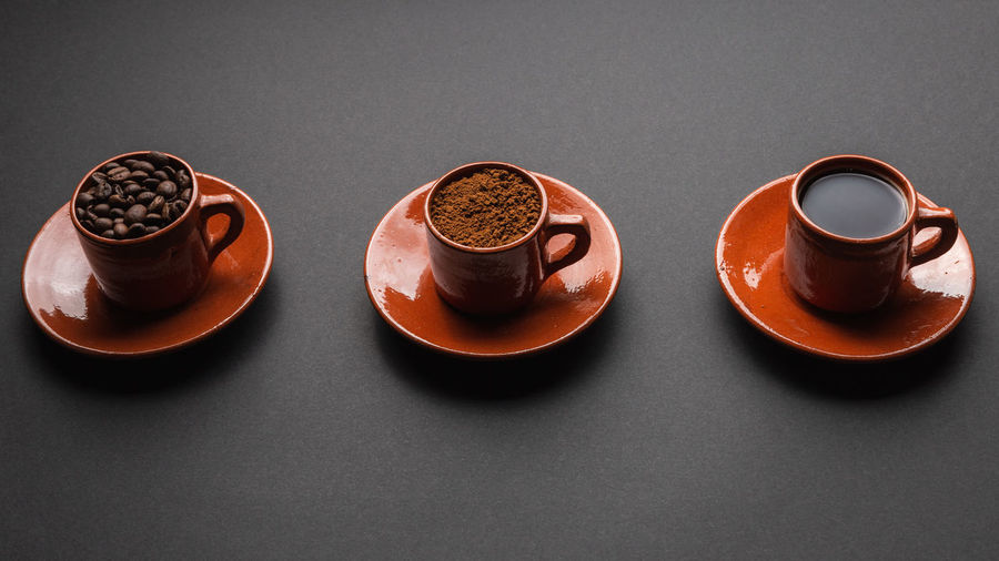 High angle view of coffee cup on table against black background