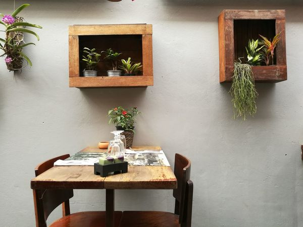 Always you and me Outdoors Side Street Siem Reap Cambodia Romance Al Fresco Dining HuaweiP9 Leicagraphy Leicaexplorer Travel Destinations Romance Anytime Anywhere Table Wood - Material Chair No People Window Home Interior