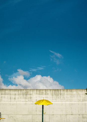 Paint The Town Yellow Architecture Beauty In Nature Blue Built Structure Cloud - Sky Day Low Angle View Nature No People Outdoors Sky Summer Water Yellow