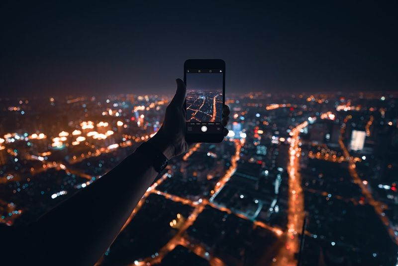 Wireless Technology Communication Technology Illuminated Building Exterior Architecture City Smart Phone Cityscape Night Portable Information Device Connection Building Photographing Human Hand