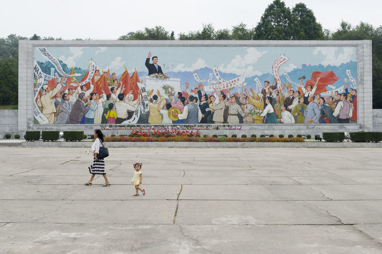 Little girl walking in front of a communist propaganda bulletin board in the capital Pyongyang, North Korea DPRK North Korea Capture The Moment EyeEm Best Edits EyeEm Best Shots OpenEdit Hello World Travel People And Places