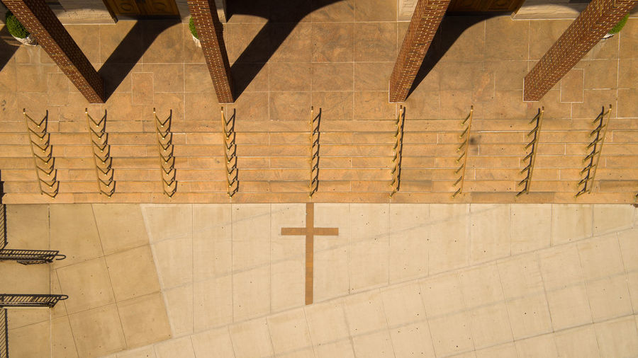 Directly above shot of cross on floor at church entrance