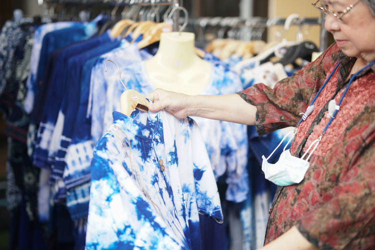 Woman looking at dress in shop