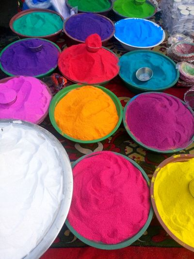 Art And Craft, Choice Circle Close-up Cultures Day Diwali Holi Indian Culture, Market Merchandise Multi Colored No People Outdoors Powder Paint Religion Retail  Variation Vertical