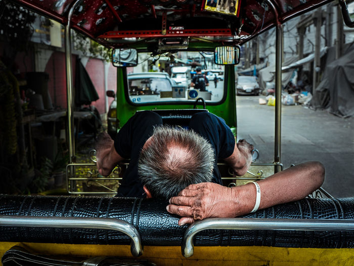 Afternoon Old Man Tuk Tuk In Bangkok TukTuk Car Day Indoors  Land Vehicle Mode Of Transport Nap One Person People Real People Rear View Relax Sitting Sleepy Transportation Tuk Tuk Tuk Tuk Driver Vehicle Seat