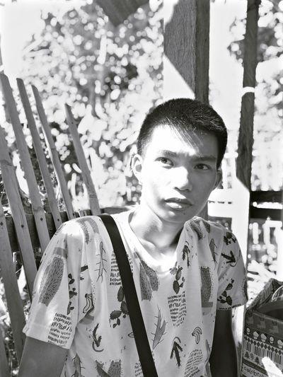 Teenage boy looking away