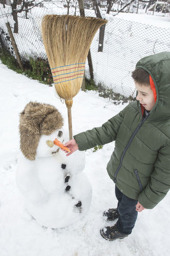 Snow Snowman Snowman⛄ Making Winter Cold Temperature Cold Play Playng Child Boy Warm Clothing One Person Clothing Childhood Leisure Activity Day Women Real People Nature Standing Females Lifestyles Outdoors Extreme Weather Innocence