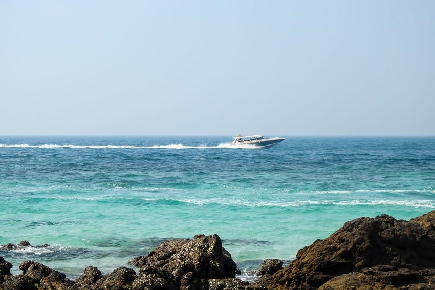 Speed Boat Rock Beach Beauty In Nature Sunlight Nature Tropical Seas Water Wave Blue Sea Blue Sky Coastline Landscape Thailand Island Vacations Tropical Island Seascape Beach Light Sand Relax Travel Islands Fast