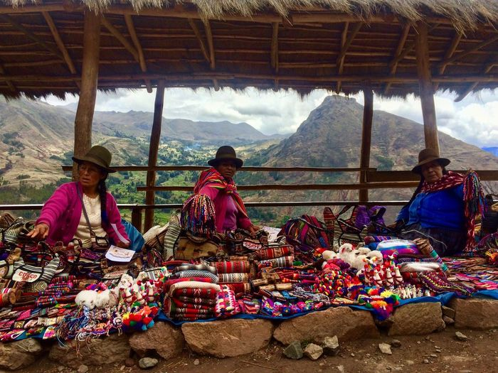 Three street sellers in the mountains of Peru EyeEmNewHere Pisac Perú Outdoors Tree Scenics Togetherness Adult Women Vacations Nature Sky People Real People Cloud - Sky Day Travel Destinations Traditional Clothing Sitting Mountain Range Hut Mountain Peru Pisac