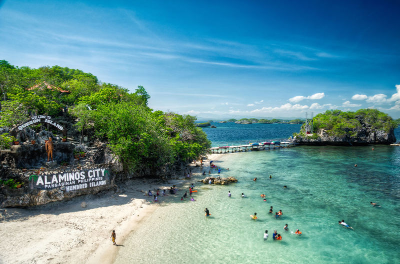 Quezon Island in HDR HDR Hdr Photography Hundred Islands  Quezon Island Beach Beauty In Nature Nature Outdoors Pangasinan Real People Sand Scenics Sea Sky Sunlight Swimming Travel Destinations Vacations Water Lost In The Landscape Connected By Travel