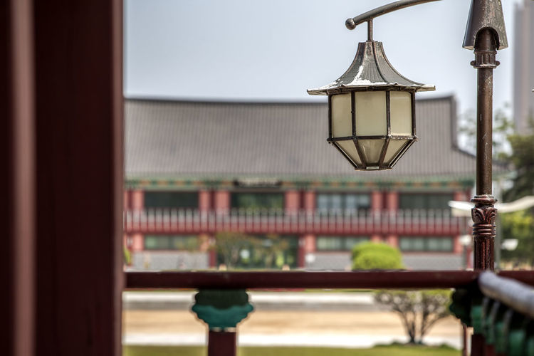 Street Light By Balcony Of Traditional Building At Michuhol Park