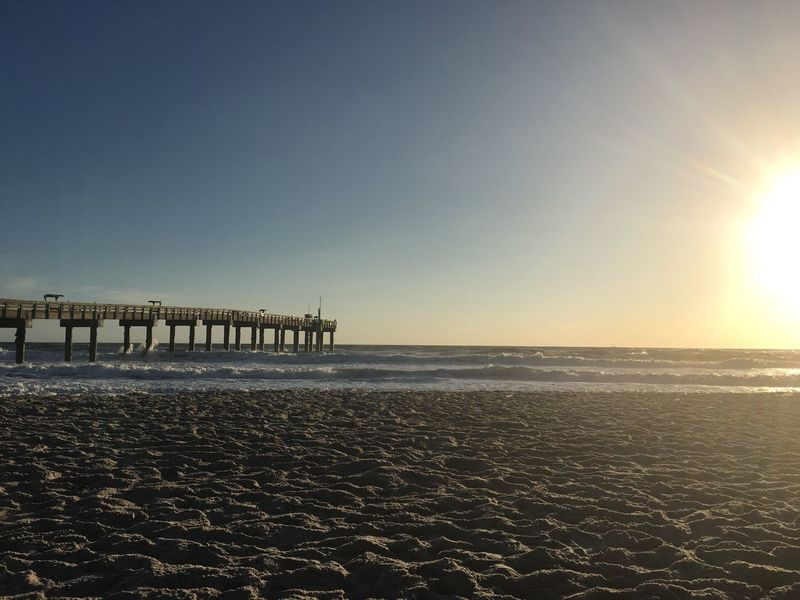 St. Augustine, Florida Beach pier Sunshine Sunrise Blue Sky Morning Light Morning Sky Pier Beach St. Augustine Beach Florida Bright Sun Bright Sunshine Sand Sea Beauty In Nature Tranquility Outdoors Shore No People Water Day Sunlight Nature Clear Sky Tranquil Scene Horizon Over Water