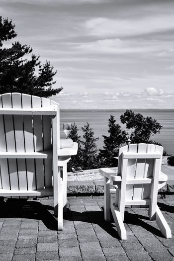 White wine and summer lawn chairs Sea Beach Chair Horizon Over Water Outdoor Chair Furniture Nature Relaxation Tranquility Sand Day Outdoors Summer Adirondack Chairs Bradley Olson Bradleywarren Photography Wine Not Wineglass Lawn Chair Copy Space No People Sky Vacations Tree Water