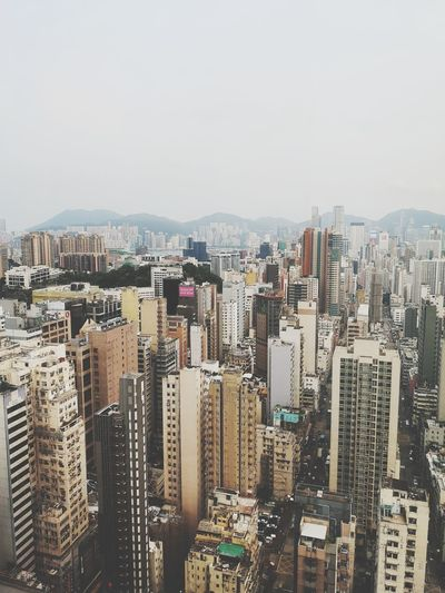 High Angle View Of Buildings In City Against Clear Sky