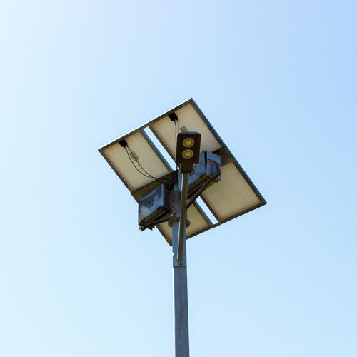 Low Angle View Of Lighting Equipment Against Clear Sky