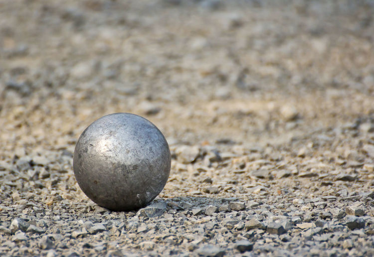 Close-up of stone ball on rock