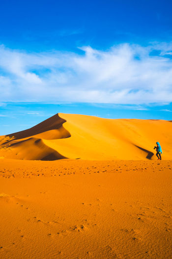A Cameraman Adventure Blue Sky Cameraman In Des Clear Sky Desert Desert Desert Beauty Environment Moroccan Desert Outdoors Sand Sand Dune Sky Sunlight The Explorer Tourism Travel Travel Explore The World