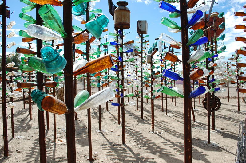 Art And Craft Blue Glass Bottle Tree Ranch BottleTree Colorful Colourful Bottles Decoration Desert Sky Glass Bottles Green Glass High Desert In A Row Metal Multi Colored Rusty Metal Shadows Vintage Glass