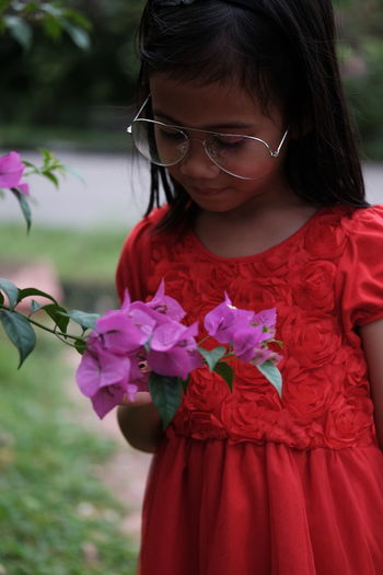 Child Girls Childhood One Person Women Real People Plant Females Focus On Foreground Front View Flower Flowering Plant Holding Leisure Activity Innocence Cute Lifestyles Nature Pink Color Outdoors Flower Head Hairstyle
