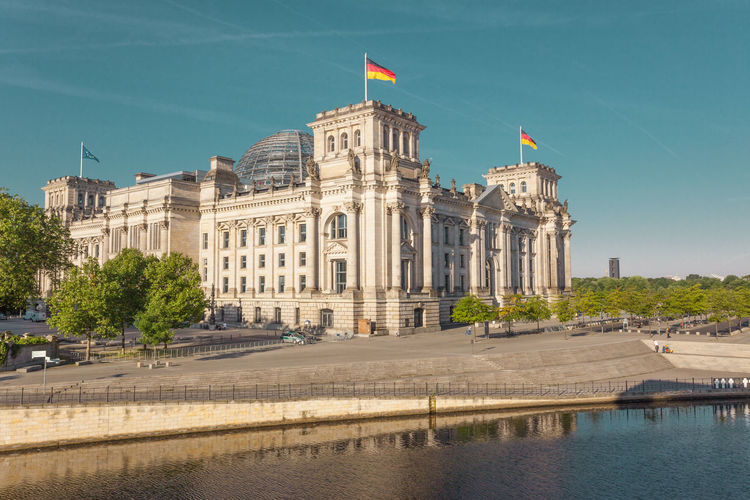 River by the reichstag against blue sky