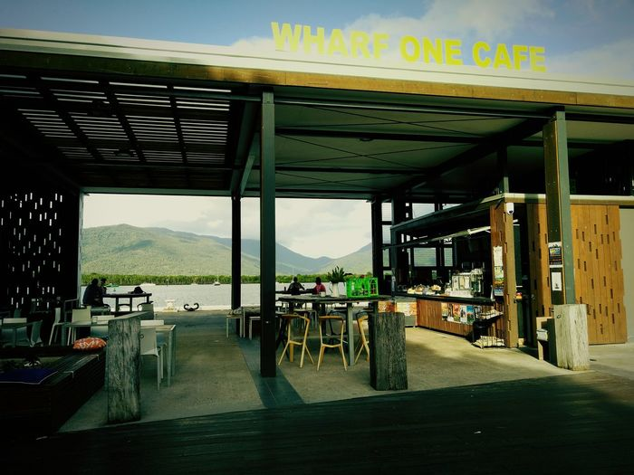 Wharf One Cafe - Everyone loves go there for lunch. Beautiful View Peoples Have A Lunch View From The Balcony Ocean View Mountains Blue Sky And White Clouds Tables And Chairs People Talking People Tourist Beautiful Photography💕