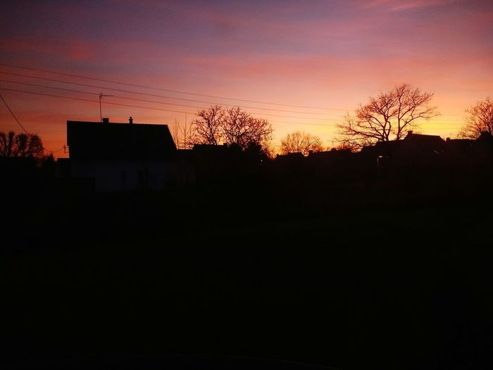 Winter afternoons Phone PhonePhotography Phone Photography Phoneography Chimney Afternoon Shadow Melancolic Evening France Motivation Motivational Tree House Power Line  Orange Blue Colors Color Fade Memories Frame It! Rooftop Roof Rooftops Sunset Silhouette No People Sky Outdoors Day