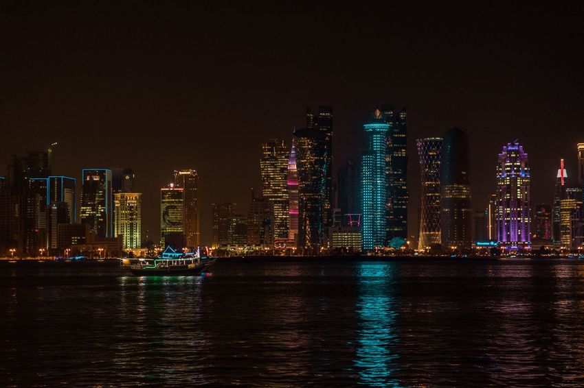 Corniche qatar Skyline Qatar Building Exterior Architecture Built Structure Night Water Landscape Building Office Building Exterior Illuminated Skyscraper Waterfront City Urban Skyline Sky Cityscape Travel Destinations Modern No People Reflection Tall - High