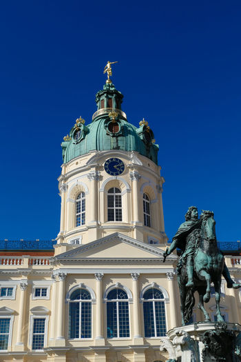 Schloss Charlottenburg Charlottenburg  Schloss Schloss Charlottenburg Architectural Column Architecture Art And Craft Blue Building Building Exterior Built Structure Clear Sky Copy Space Day History Human Representation Low Angle View Nature No People Representation Sculpture Sky Statue The Past Travel Destinations