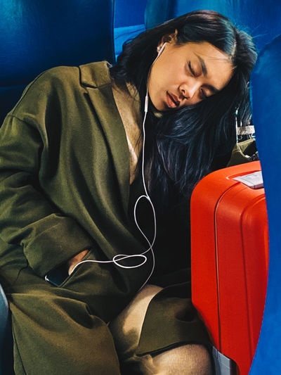 Young woman sleeping on train