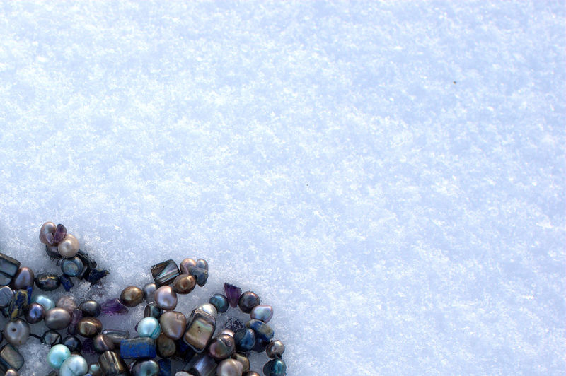 Directly Above Shot Of Beads In Snow