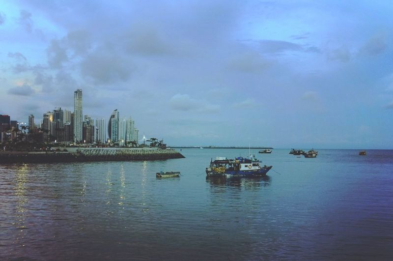 Water Nautical Vessel Sky Transportation Building Exterior City Architecture Sea Built Structure Mode Of Transportation Cloud - Sky Nature No People Waterfront Ship Office Building Exterior Scenics - Nature Reflection Tranquility Cityscape