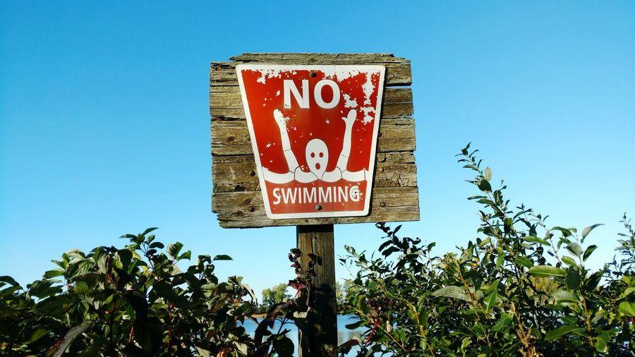 Close-up of no swimming sign